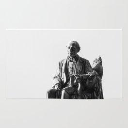 old man statue Rug