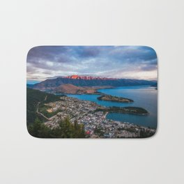 Red light on the Remarkables mountain in Queenstown at sunset Bath Mat