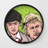 caleb troy Wall Clocks featuring Troy and Rowsdower by turddemon