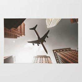 airplane in manhattan Rug