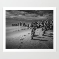 Footprints and Pilings on the Beach in Black and White at Kirk Park by Grand Haven Michigan Art Print