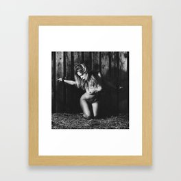 Naked woman bound with old iron shackles Framed Art Print