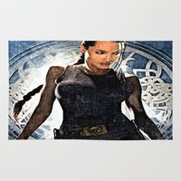 angelina jolie Area & Throw Rugs featuring Angelina Jolie as Lara Croft by Brian Raggatt