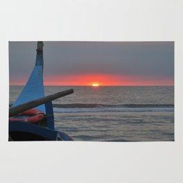 Sunset on an ocean beach Rug