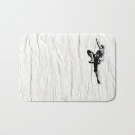 Woman Climbing a Wrinkle Bath Mat