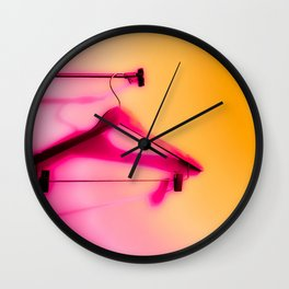wood hanger with pink and orange background Wall Clock