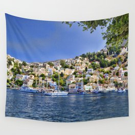 Symi island in Greece. Traditional houses. Sunny day with blue sky and sea. Wall Tapestry