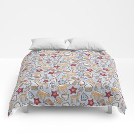 Gingerbread on light blue background Comforters