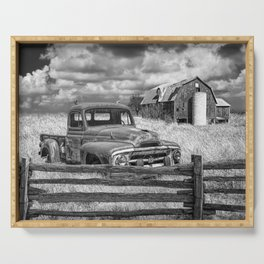 Black and White of Rusted International Harvester Pickup Truck behind wooden fence with Red Barn in Serving Tray
