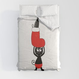 Cute black cat holding Christmas sock and champagne bottle Comforters