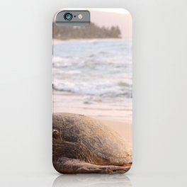 SHALLOW FOCUS PHOTOGRAPHY OF TURTLE LYING ON BEACH SAND IN THE MORNING iPhone Case