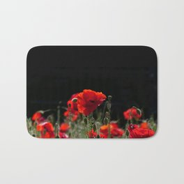 Red Poppies in bright sunlight Bath Mat