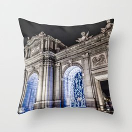 Puerta de Alcala in Madrid at night Throw Pillow