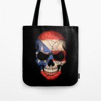 puerto rico Tote Bags featuring Dark Skull with Flag of Puerto Rico by Jeff Bartels