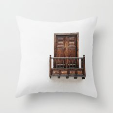 Wooden window door and balcony in a white wall. La Palma, Canary Island. Throw Pillow