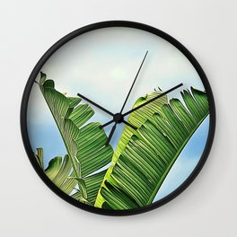 Frayed Palm Fronds Against Blue Sky Wall Clock
