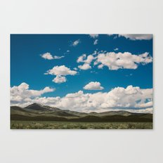 Puffy White Clouds with Blue Sky and Green Meadow Hills Canvas Print