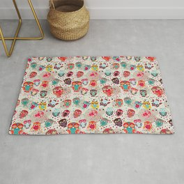 pattern with colorful owls on cream background Rug