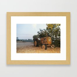 Old tractor on a pebble beach by a river Framed Art Print