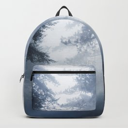 Sun rays shinning through foggy forest Backpack
