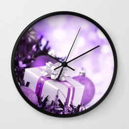 Purple Christmas scene with baubles and gift Wall Clock