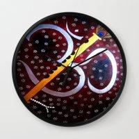 om Wall Clocks featuring Om by Priyanka Rastogi