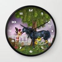 the last unicorn Wall Clocks featuring The Last Black Unicorn by Simone Gatterwe