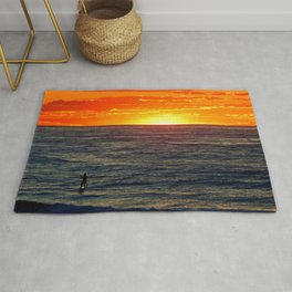 Paddle Boarding at Sunset Rug