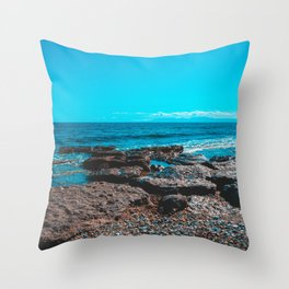 Rocks at bay with blue sky Throw Pillow