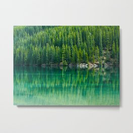Reflective Green Pine Forest With Green Turquoise Waters Metal Print