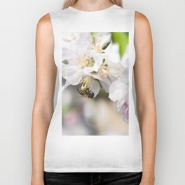 Bee collects pollen sitting on the apple tree flower Biker Tank