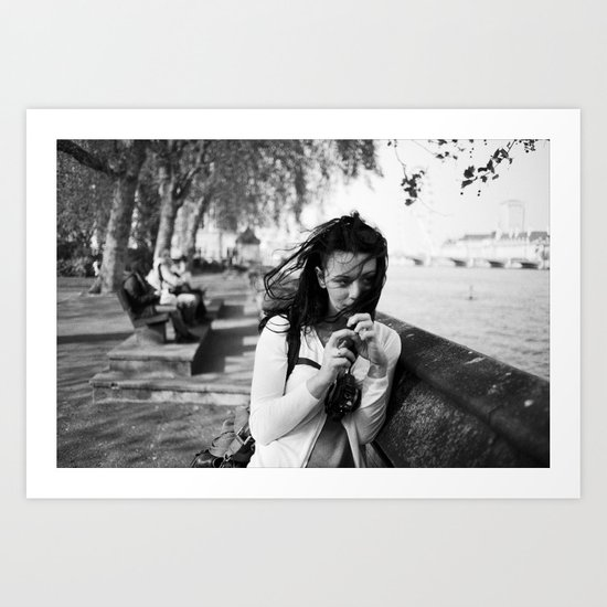 windswept girl by the thames Art Print