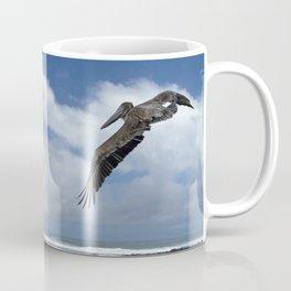 Pelican above the beach Coffee Mug