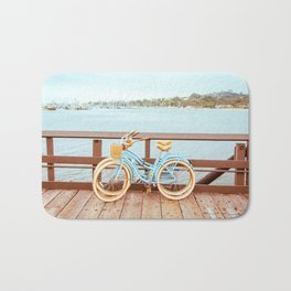Two retro bicycles standing on Santa Barbara pier, California, USA. Vintage filter with muted teal blue and orange colors. Bath Mat