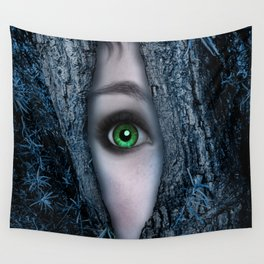 Big green eye in a blue tree Wall Tapestry