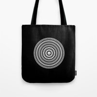buddhism Tote Bags featuring MANDALA IM ZÜRICH by THE USUAL DESIGNERS