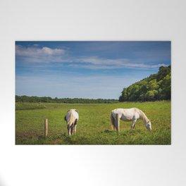 Horses grazing in Ireland Welcome Mat