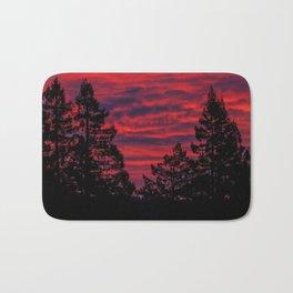 Black Trees Against a Flaming Sky Bath Mat