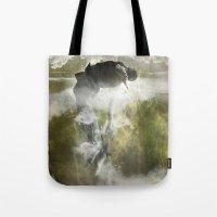 arya Tote Bags featuring Man floating by ARTiSTiC TENDENCiES