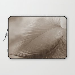 The feather hovers over the clouds Laptop Sleeve