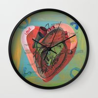anatomical heart Wall Clocks featuring Anatomical Sacred Heart by Silva Ware by Walter Silva