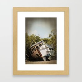 Grounded boat in need of some care Framed Art Print