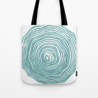 tree rings Tote Bags featuring Tree Rings by Miami and Ema