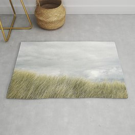 Beach grass and clouds Rug