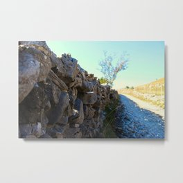 Stones stacked in the wall Metal Print