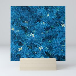 Blue fluorescent indigo flowers Mini Art Print