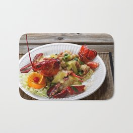 Steamed whole Maine lobster with fresh garnishes Bath Mat
