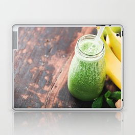Close-up of green fresh smoothie with fruits, berries, oats and seeds, selective focus. Laptop & iPad Skin