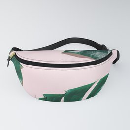 Green monstera leaves on pink ink Fanny Pack