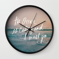 leah flores Wall Clocks featuring The Ocean is Calling by Laura Ruth and Leah Flores by Leah Flores